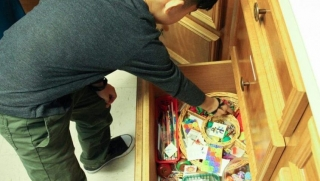Bellmead Kids Dentistry patient looking through assortment of activities and promotional gifts cabinet drawer