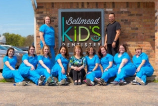bellmead smiles team photo in front of building sign
